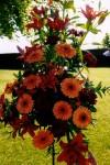 Orange wedding flower arrangement