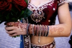 Indian bride with henna and bracelets