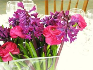 pink ranunculus and purple hyacinth wedding table arrangement