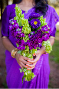 bridesmaid wearing purple sari with purple wedding bouquet