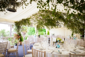 Interior of wedding marquee with greenery