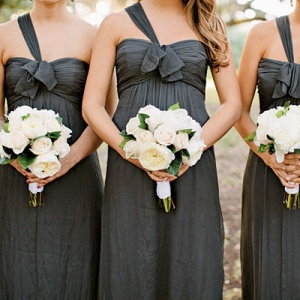 Grey bridesmaid dresses with their flowers